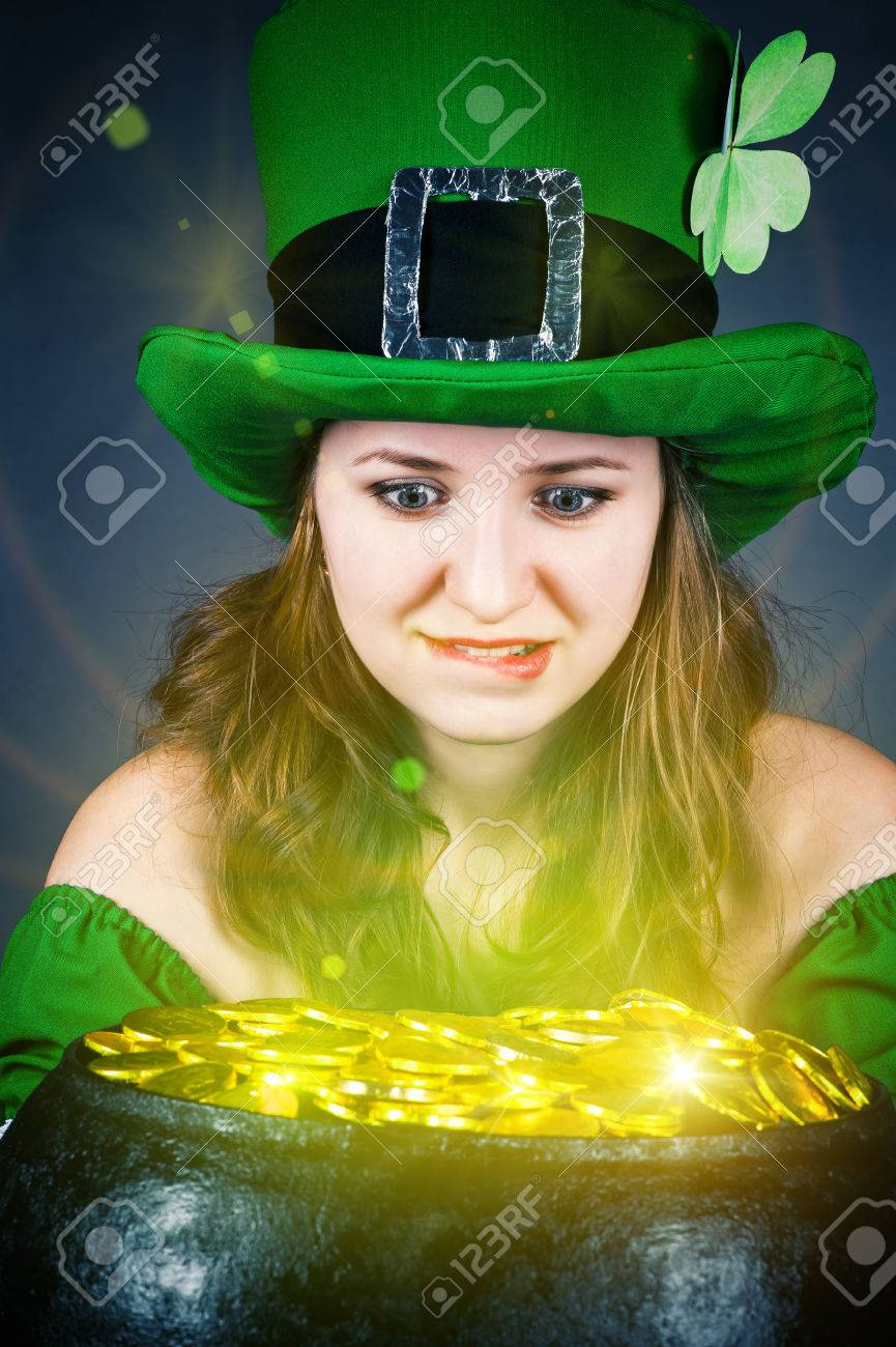 a woman dressed as a leprechaun with greedy eyes Stock Photo - 25401058