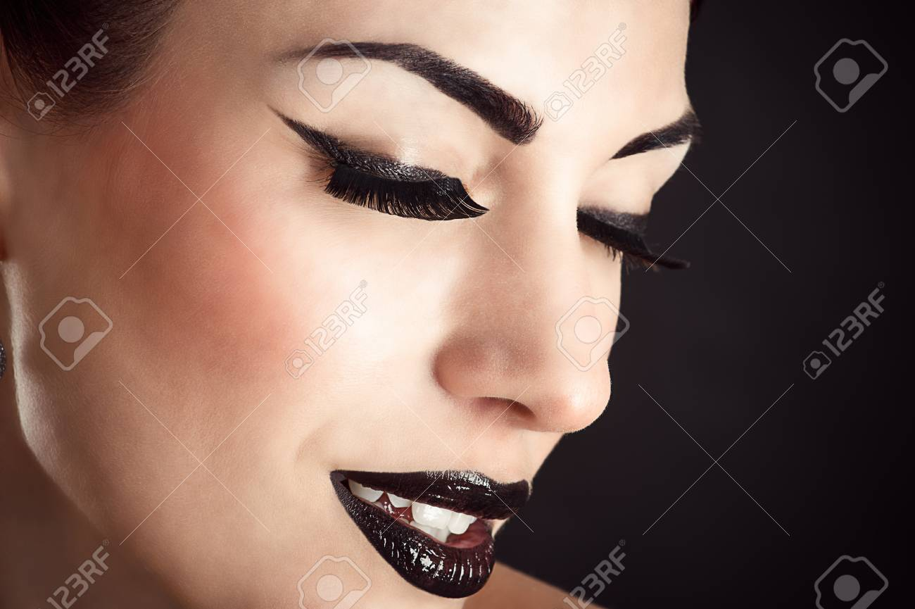 Beauty Model Face With Black Makeup And Long Eyelashes Stock Photo