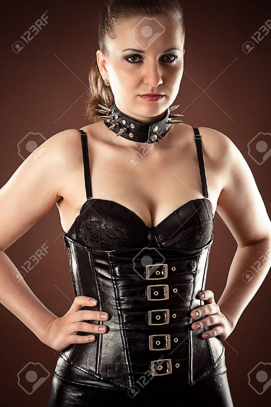 ec0afe45f88 beautiful woman in corset and spiked collar Stock Photo - 29384805