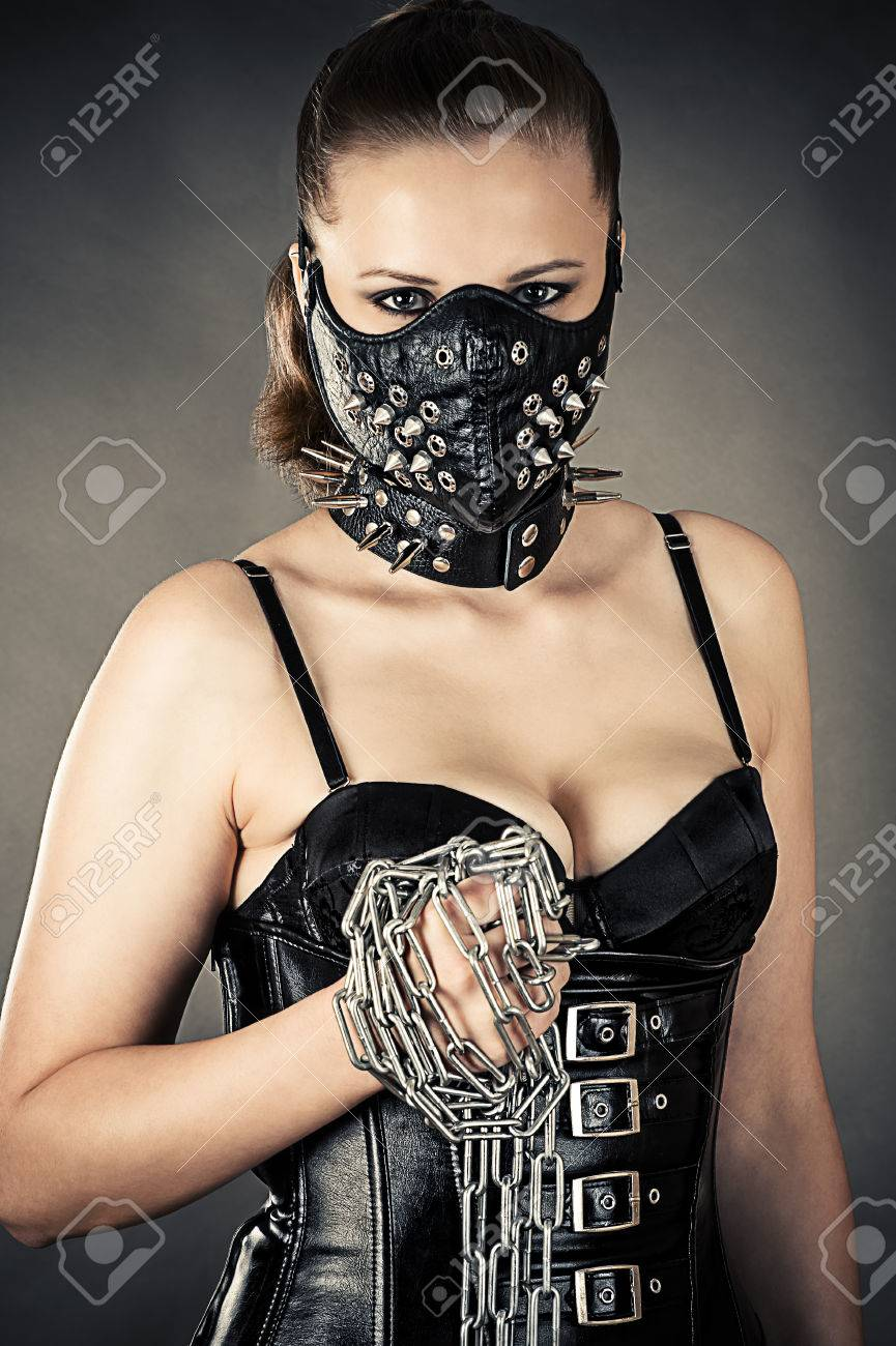 cc60fda8b84 beautiful woman in a mask with a chain in hand Stock Photo - 29384826