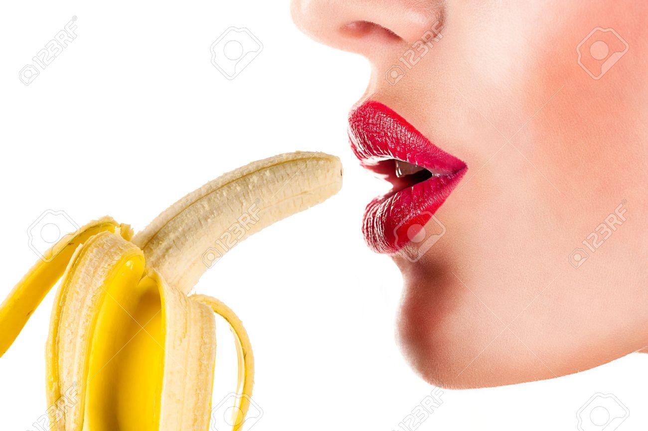 Sexy girl eating a banana