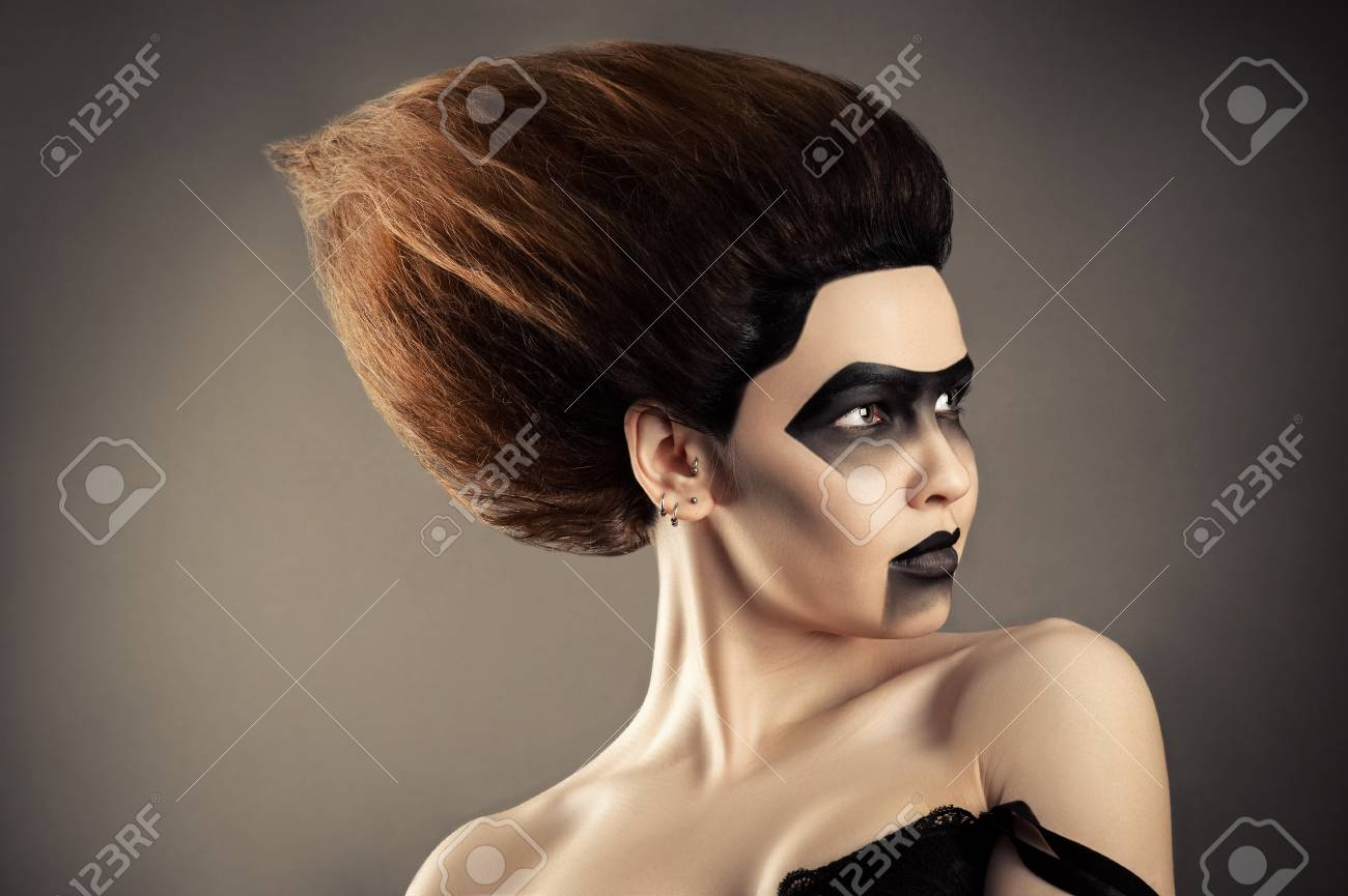 Brunette Woman With Fashion Hairstyle And Creative Dark Makeup Stock