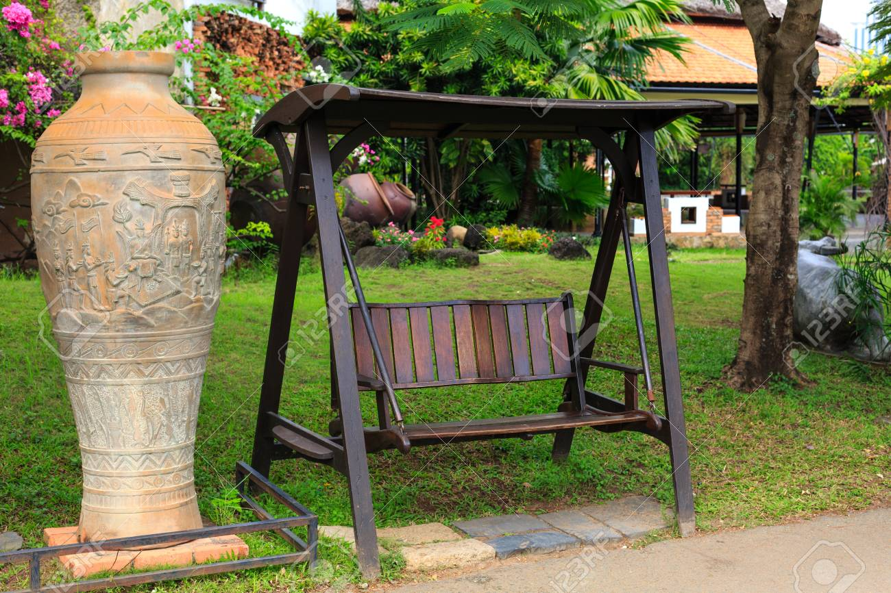 Tremendous Outdoor Wooden Bench Swing In The Green Park A Large Ceramic Spiritservingveterans Wood Chair Design Ideas Spiritservingveteransorg