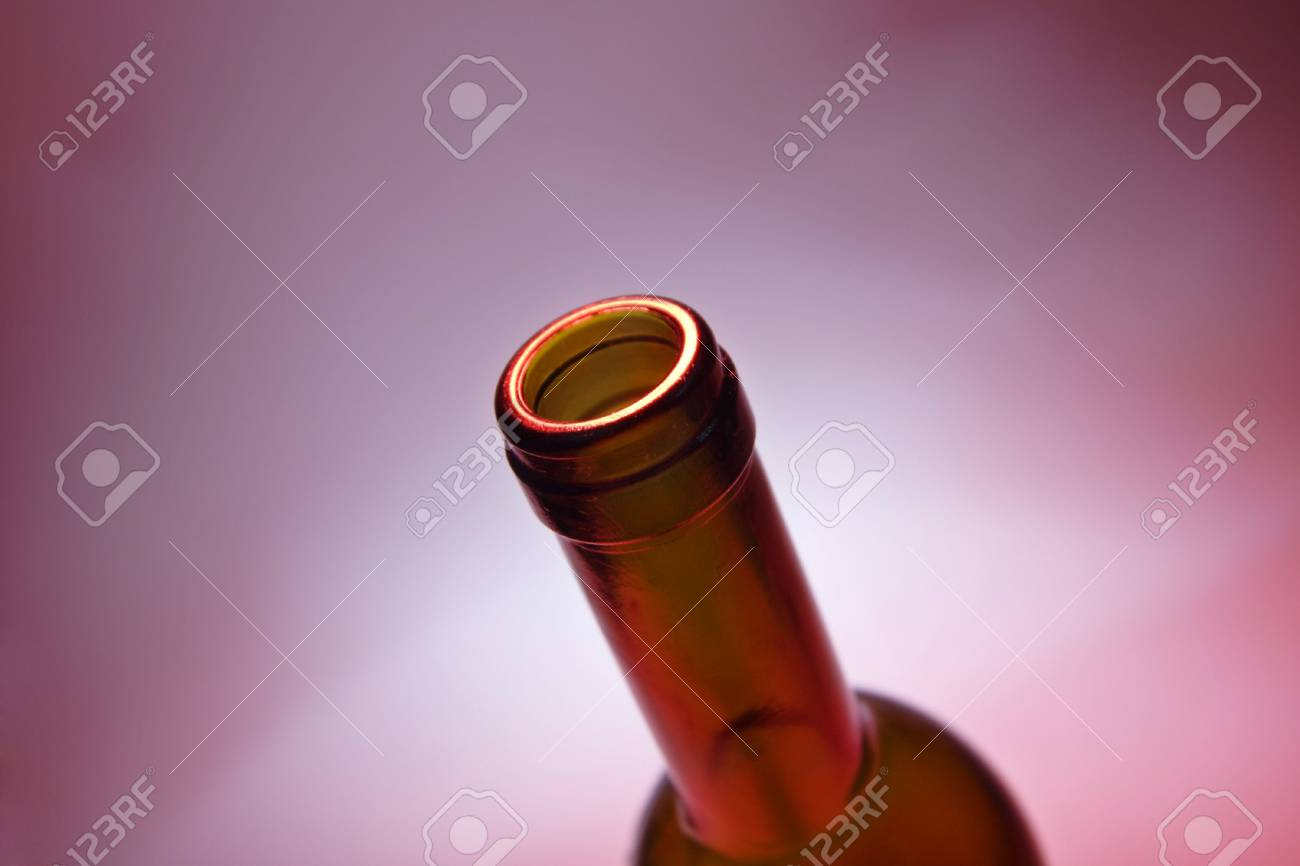 opened bottle of red wine on red ambient background Stock Photo - 719383