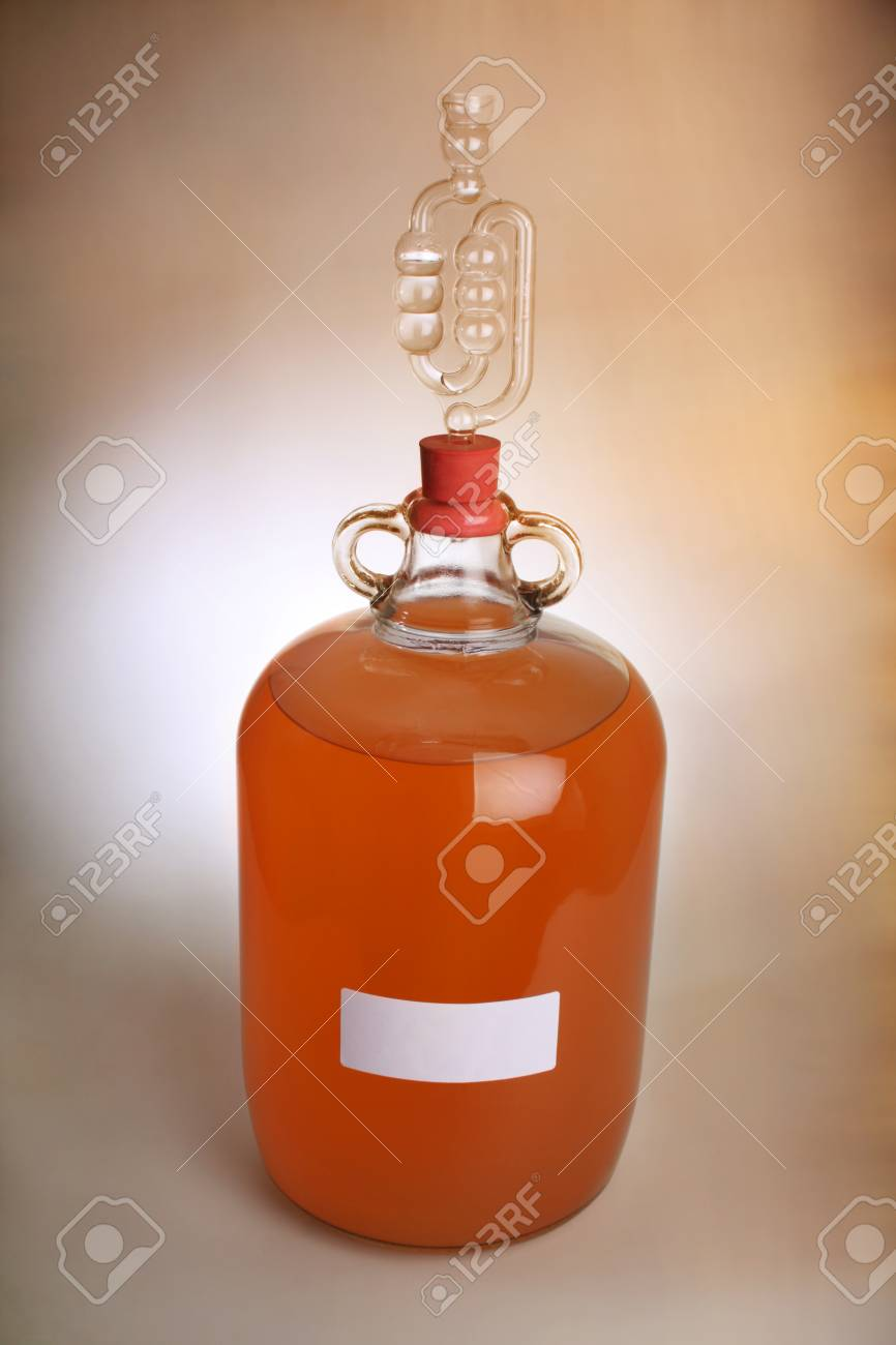 Peach Wine In A Demijohn With Airlock In Place Due To Wine Still