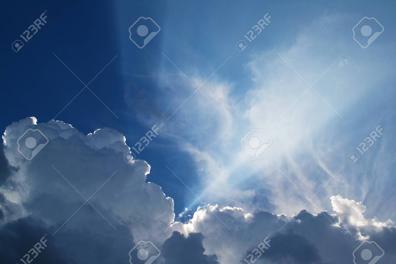Beautiful clouds feathers against the blue sky, consecrated by the sun, background for design. - 120596189