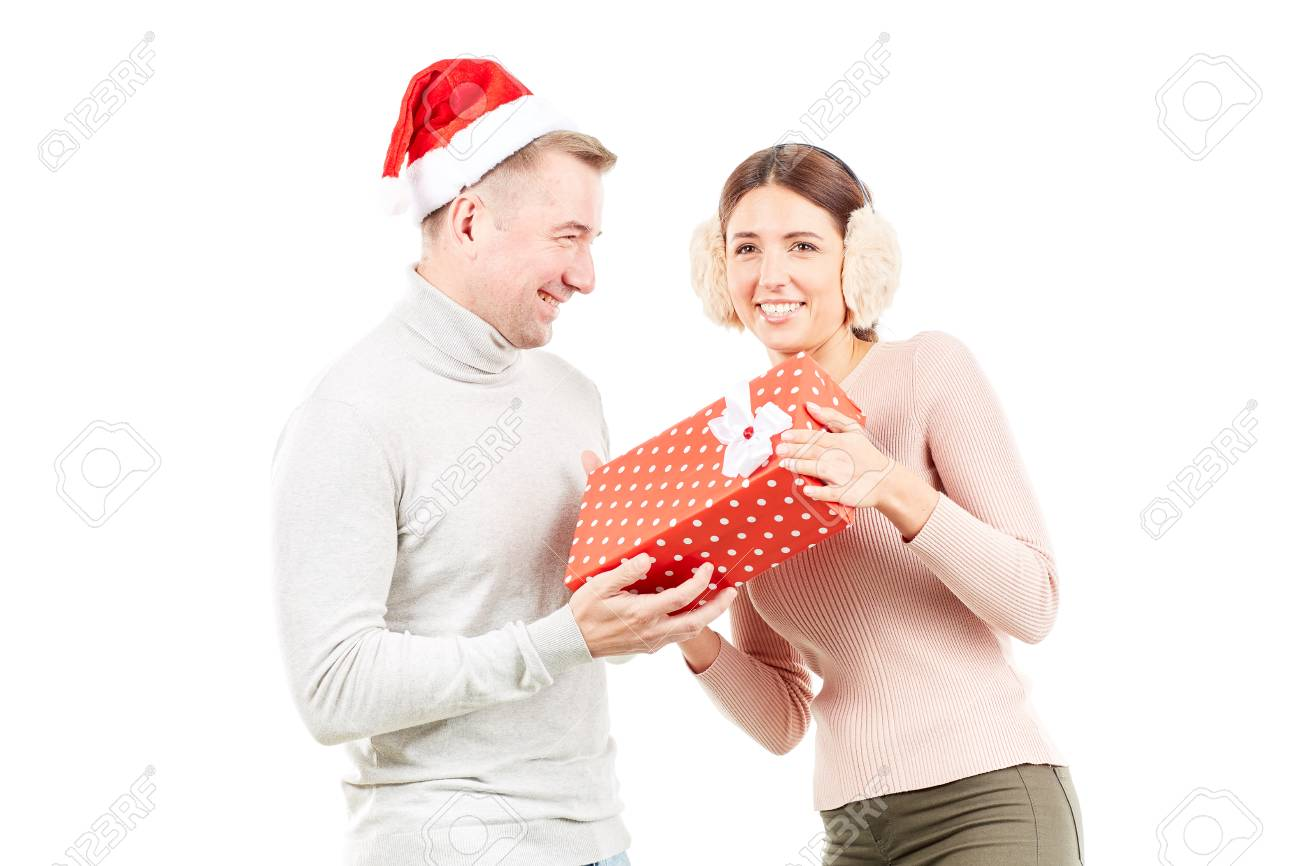 094f2556f7 Studio portrait of man and woman with Christmas present on white background  Stock Photo - 88358944