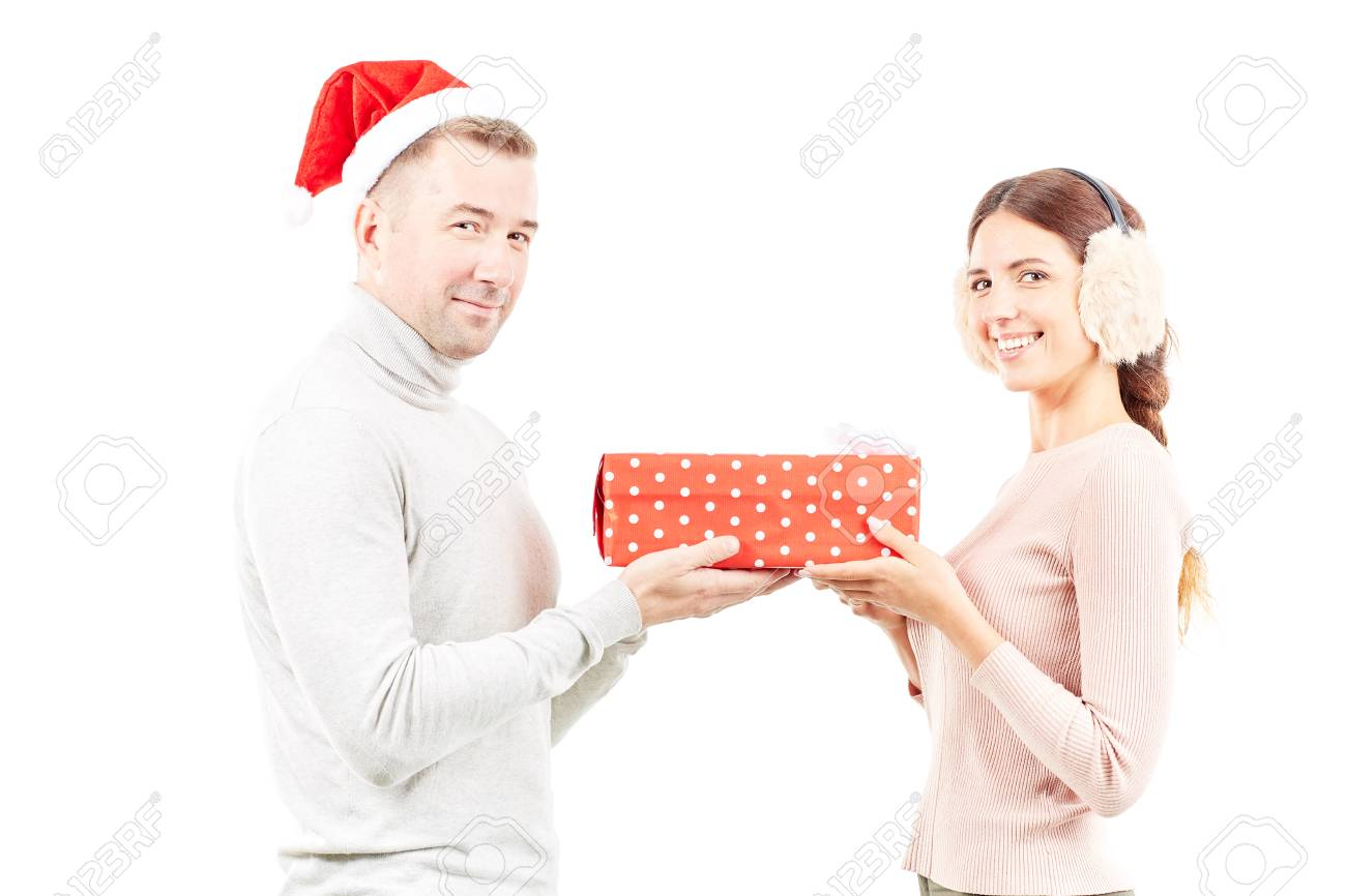 9ab32b2790 Studio portrait of man and woman with Christmas present on white background  Stock Photo - 91752279