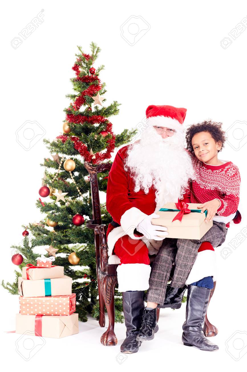 Mixed-race Little Boy Receiving Christmas Gift From Santa Claus ...
