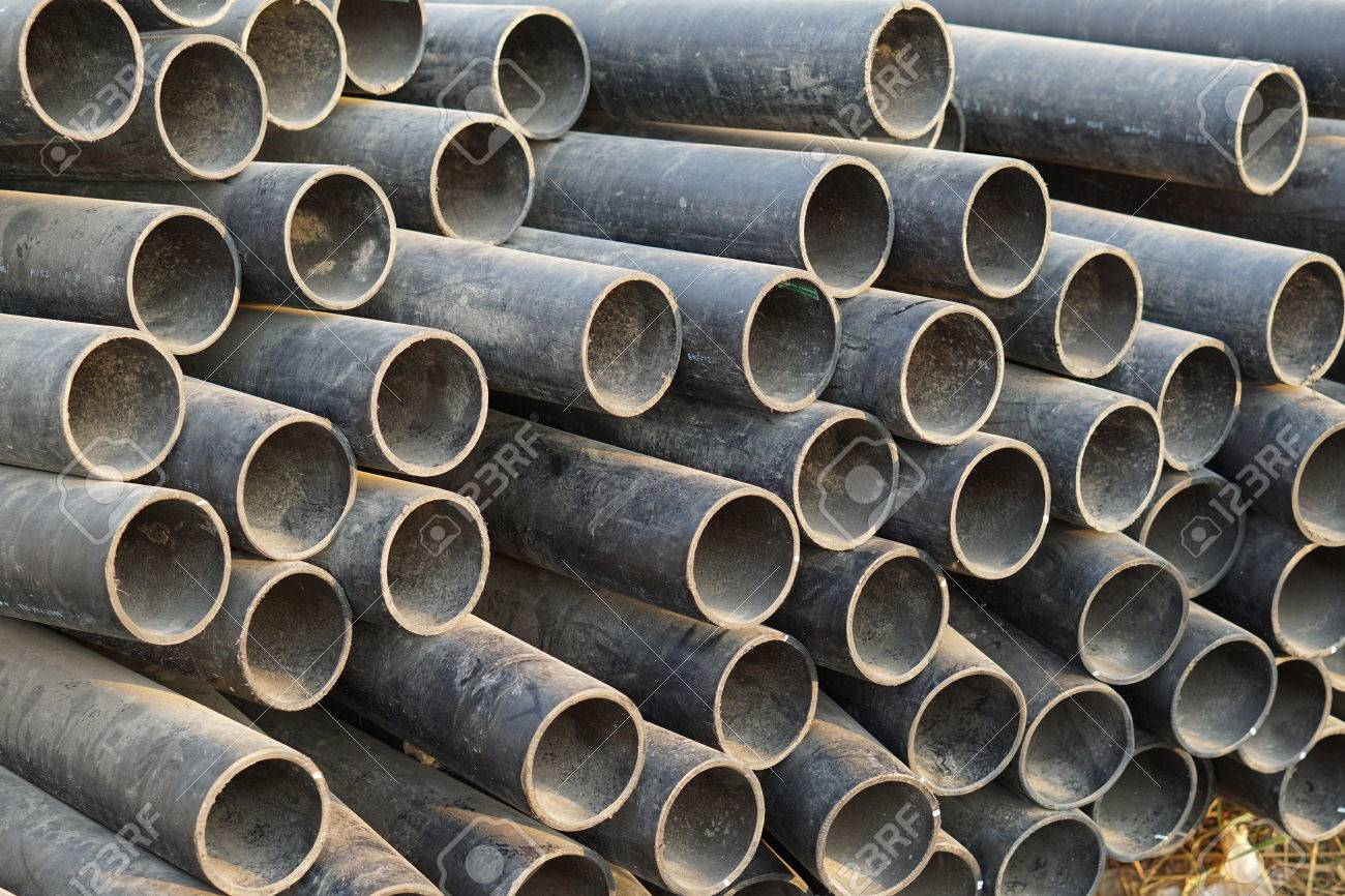 High-density Polyethylene (HDPE) pipe tube stack in nature evening