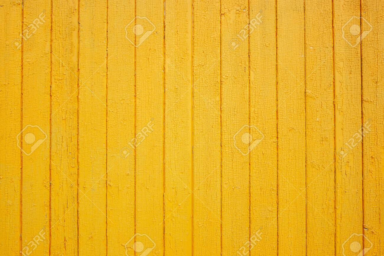 Wooden yellow wall texture. Grain wood background. Place for text. Texture for design. Bright wood - 129840755