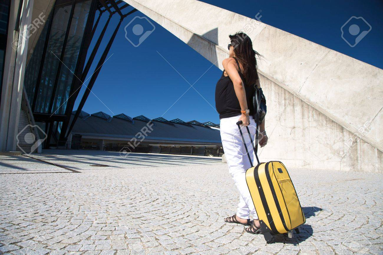 woman with trolley outside the lyon airport Stock Photo - 6040035