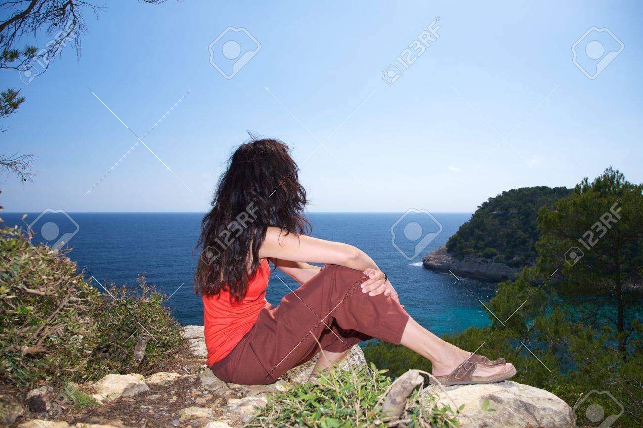 Woman on top at Menorca island in Spain Stock Photo - 9286463