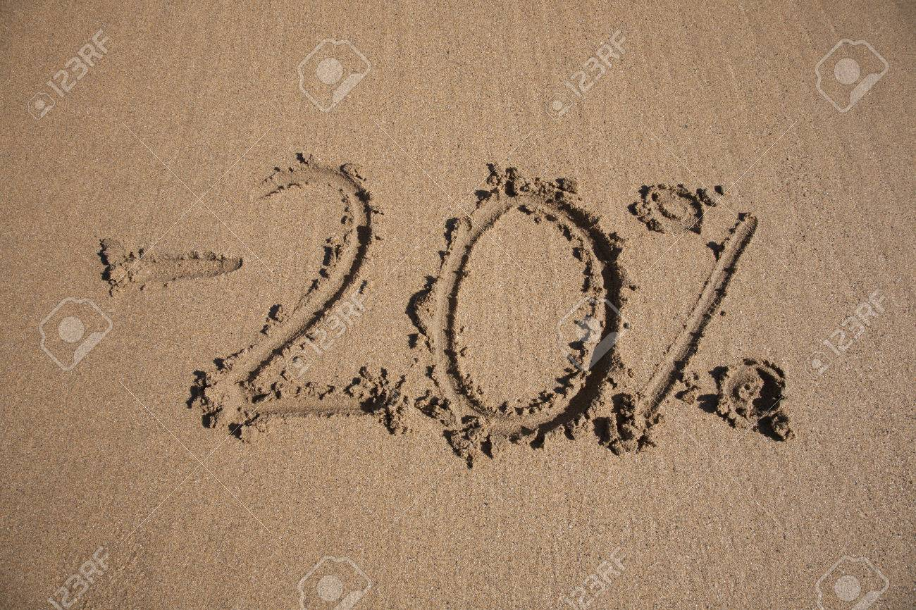 20 per cent discount in earth text written on brown sand ground 20 per cent discount in earth text written on brown sand ground low tide beach ocean biocorpaavc