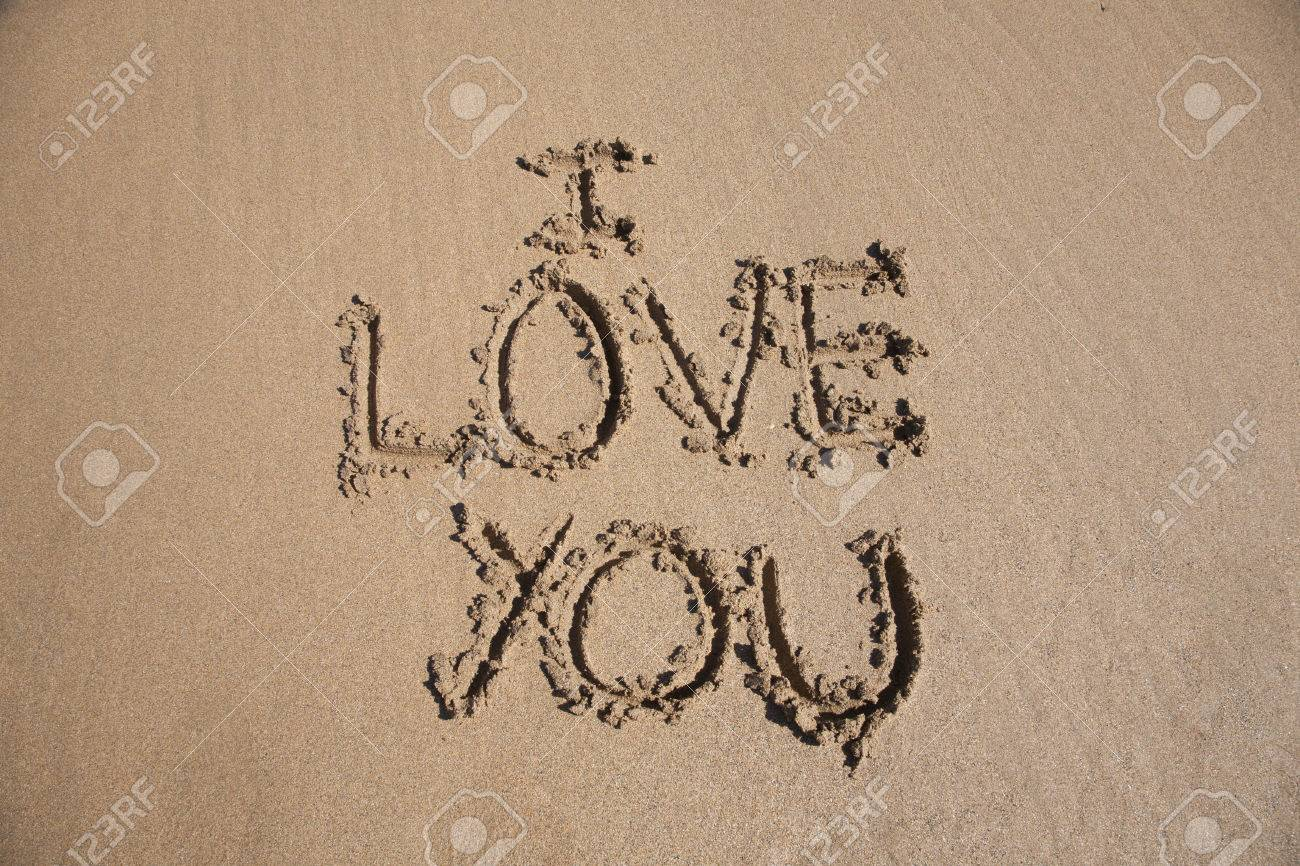 I Love You Text Written On Brown Sand Ground Low Tide Beach Ocean