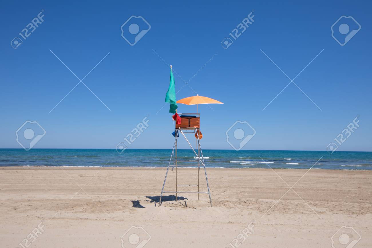 lifeguard high chair with orange parasol and green flag in Pine Beach in Grao of & Lifeguard High Chair With Orange Parasol And Green Flag In Pine ...