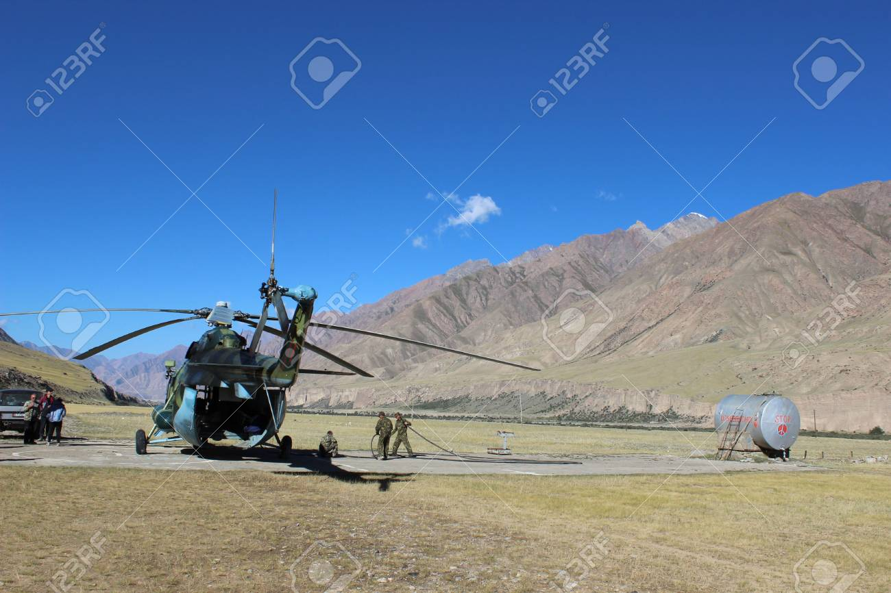 Soviet helicopter with climbers in Maida Adyr,  Kyrgyzstan  Stock Photo - 17261451