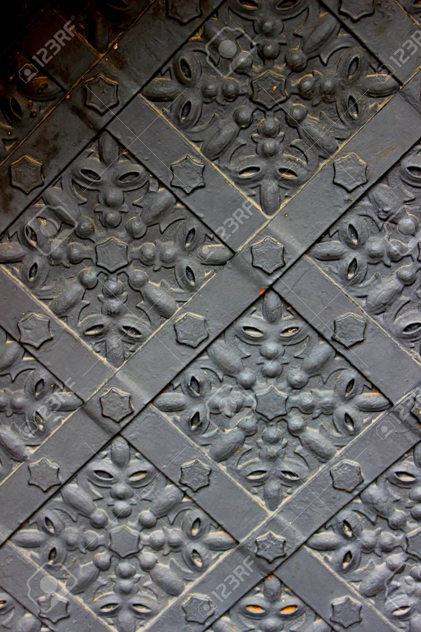 Old door with ornament in stone wall Stock Photo - 19446562