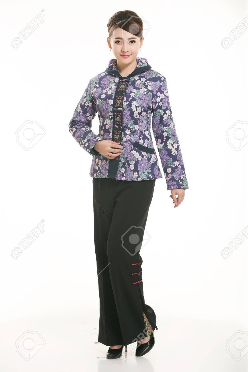 4a74d8e16ba6 Stock Photo - Wearing cotton padded jacket China lady on white background