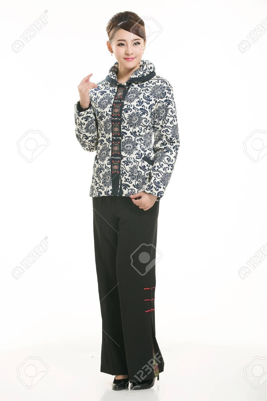 148503558599 Stock Photo - Wearing cotton padded jacket China lady in white background
