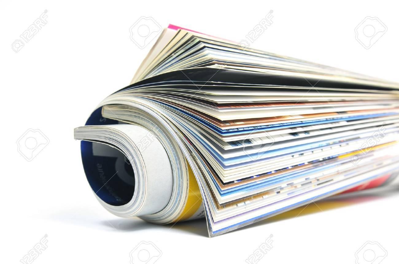 Rolled gossip magazine over white background Stock Photo - 10886590