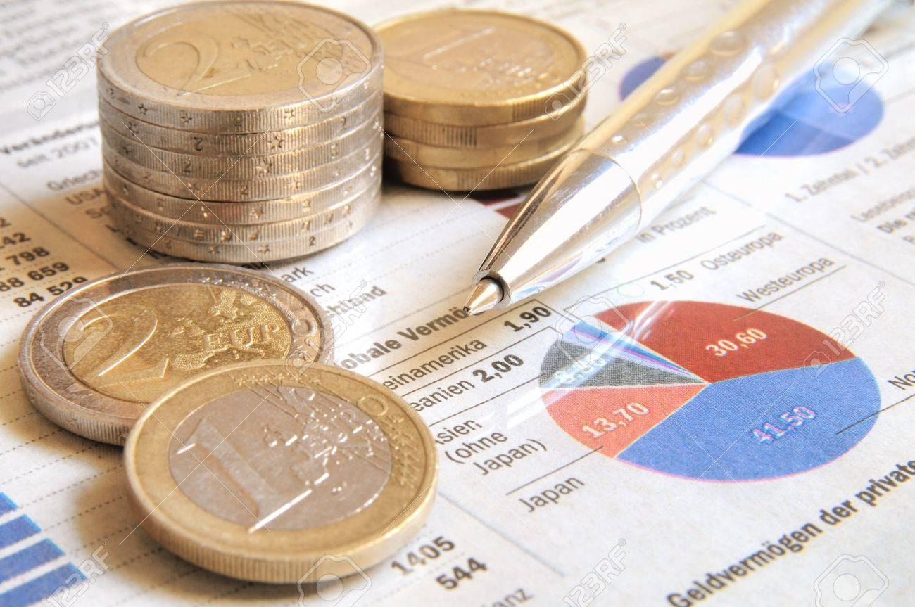 Euro money and ball pen on a international revenue report Stock Photo - 14972525