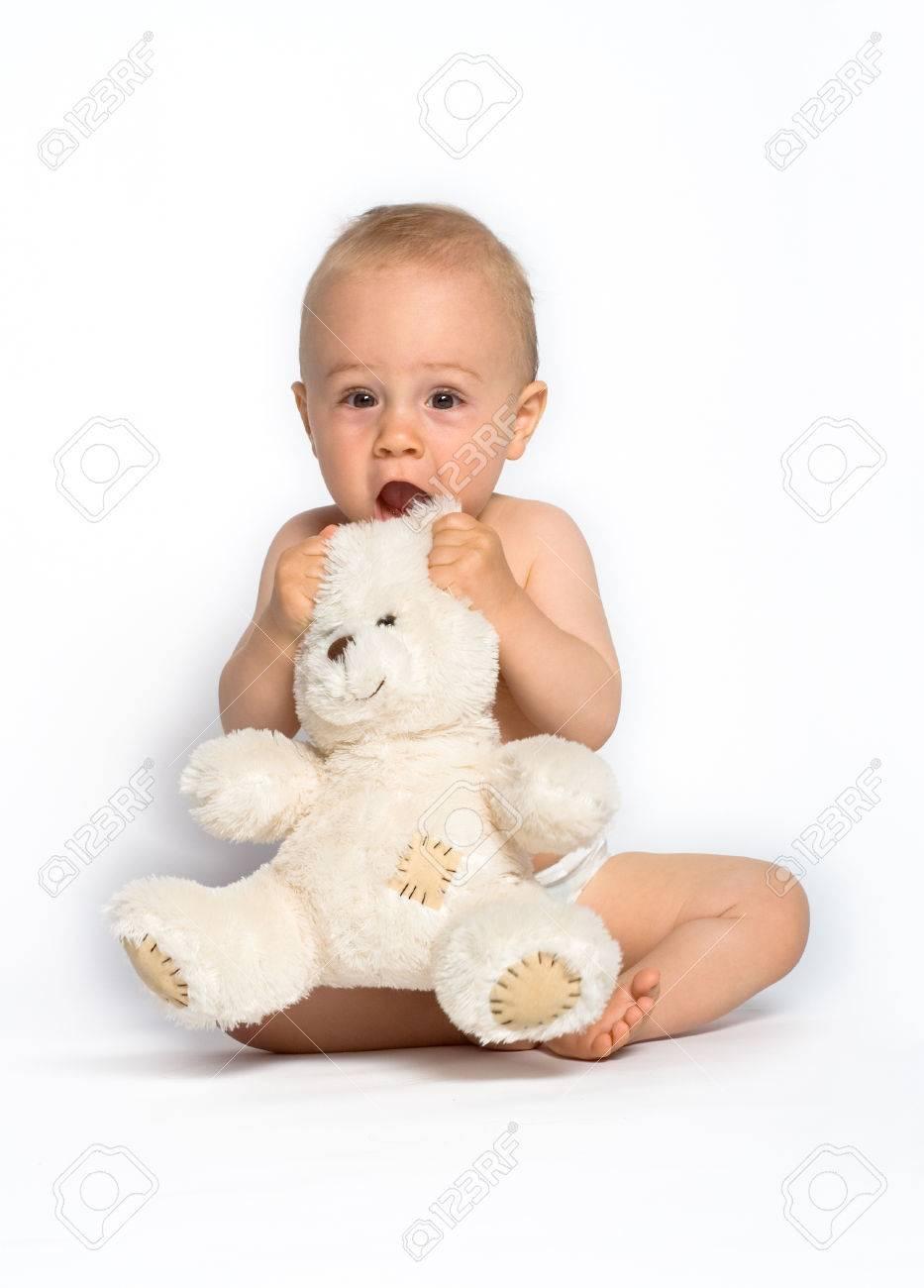 Cute little boy holding a white, stuffed teddy bear. White background. Stock Photo - 1677664