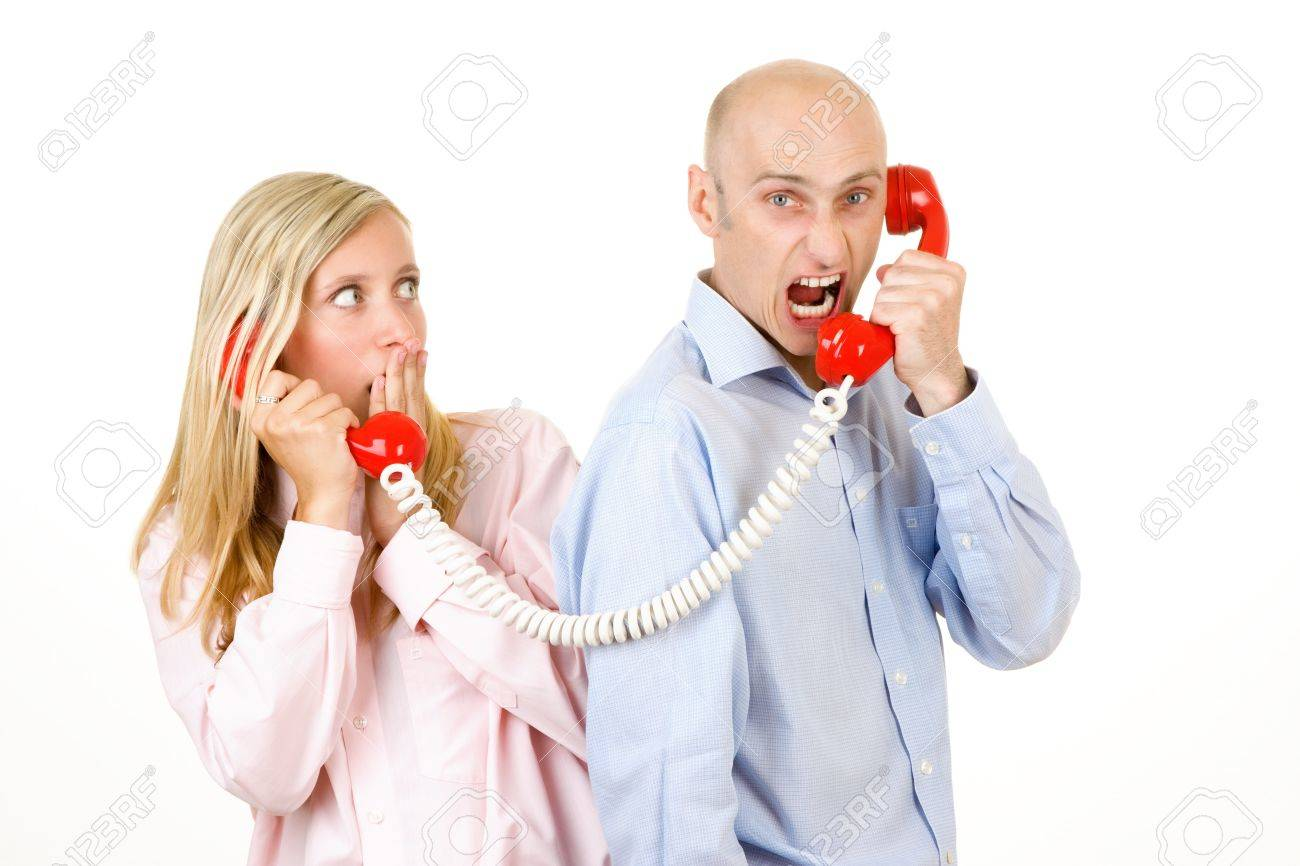 Upset man yelling at a frightened young woman on a red telephone. Stock Photo - 9526319
