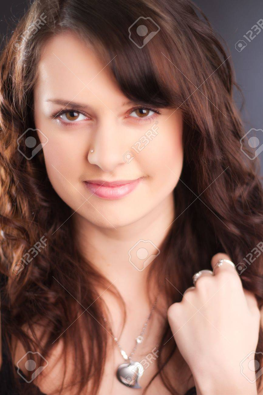 A portrait of a beautiful young girl with a pierced nose and long brown hair. Stock Photo - 9526681