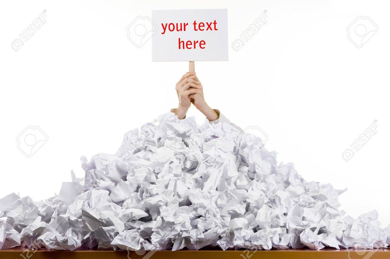 Office worker with sign buried in pile of screwed up papers, white studio background Stock Photo - 9570882
