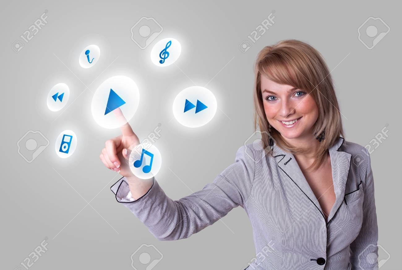 woman hand pressing media player button Stock Photo - 8725489