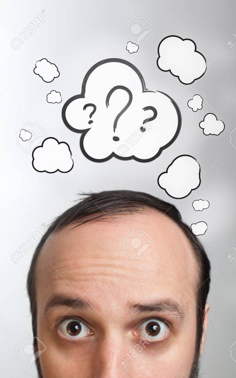 Funny Young guy with question mark over his head Stock Photo - 9342287