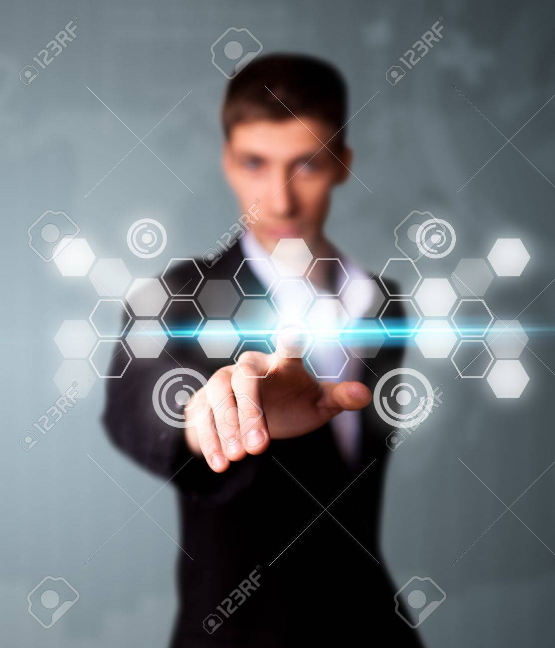 Man pressing digital button, futuristic technology Stock Photo - 9342338