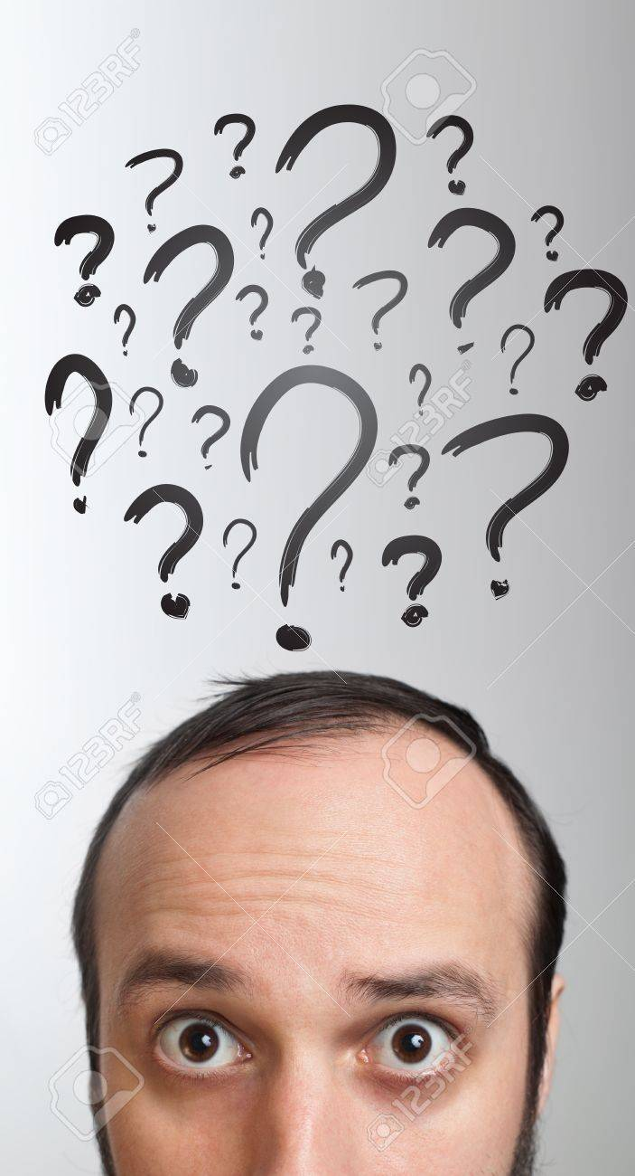 Young white Caucasian male adult has way too many questions in his head Stock Photo - 9369275