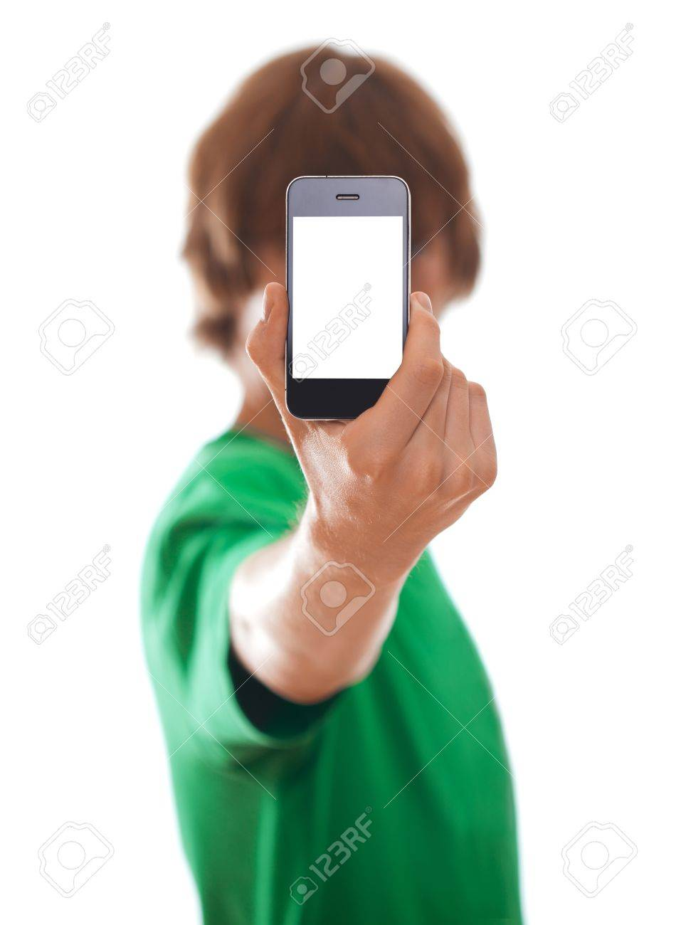 Young man holding modern phone, isolated on white [selective focus] Stock Photo - 10087826