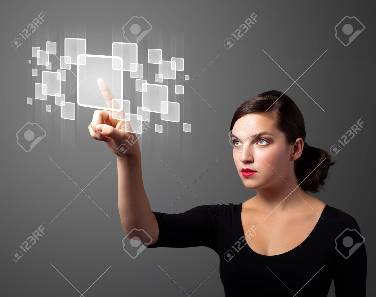 Businesswoman pressing high tech type of modern buttons on a virtual background Stock Photo - 11026937