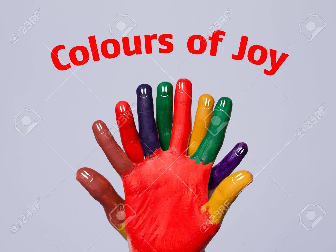 Colorful Happy Finger Smileys With Colours Of Joy Sign On Grey