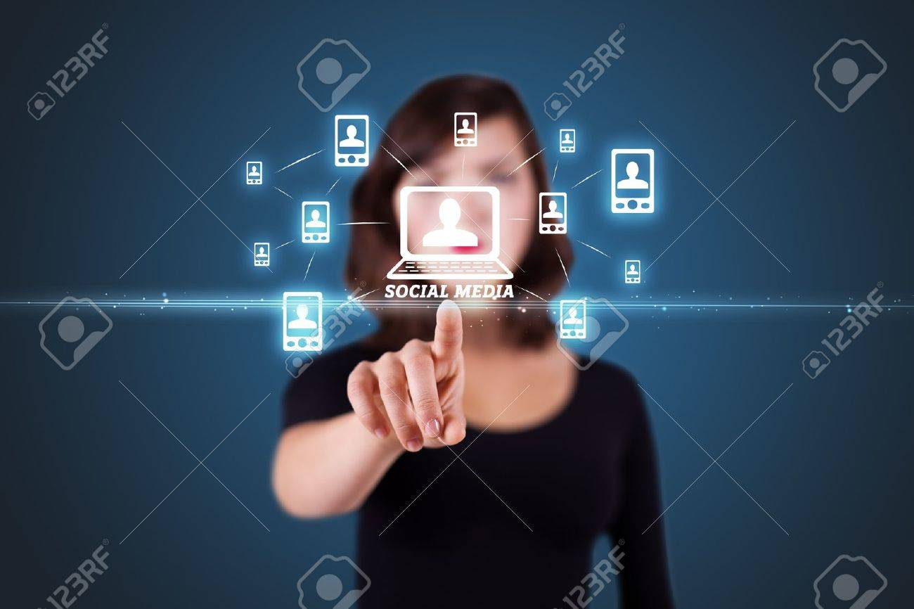 Businesswoman pressing modern social buttons on a virtual background Stock Photo - 11256520