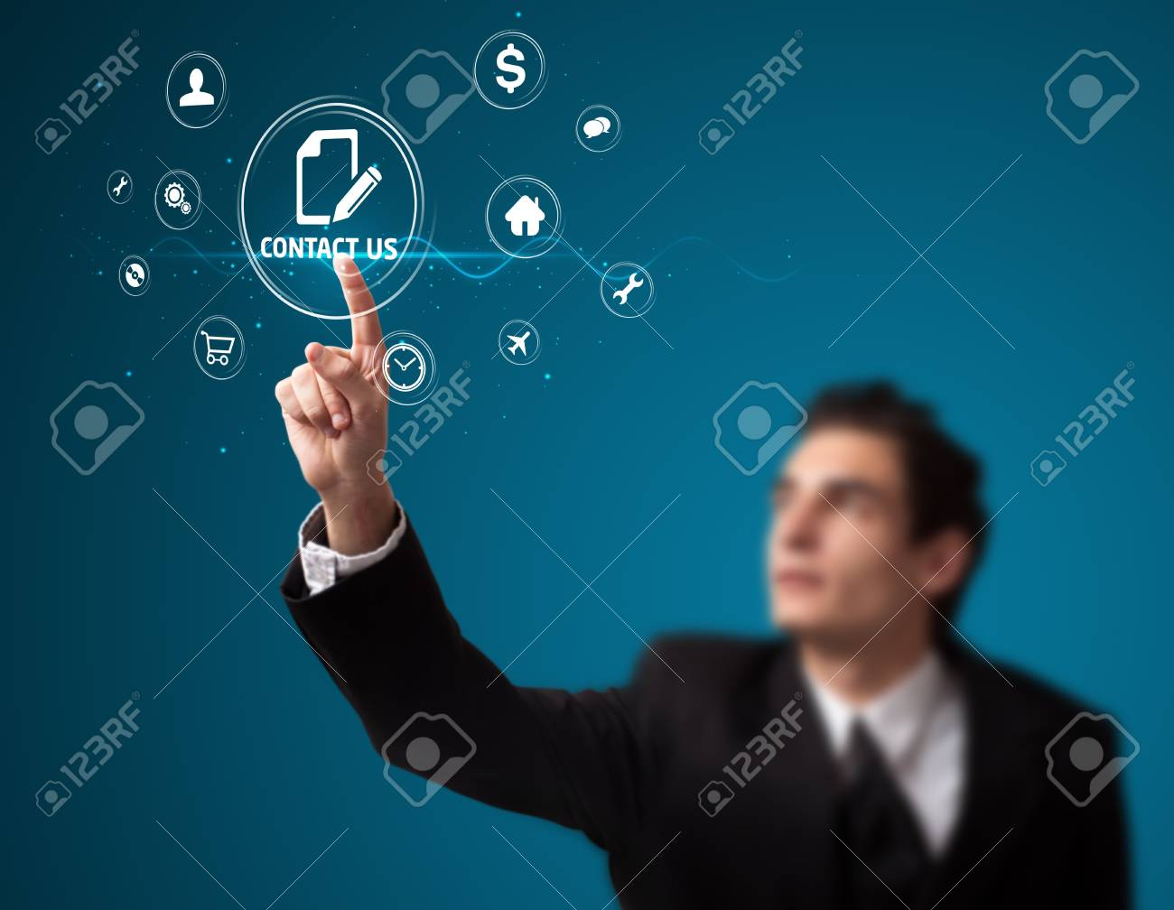 Businessman pressing messaging type of modern icons with virtual background Stock Photo - 12089358