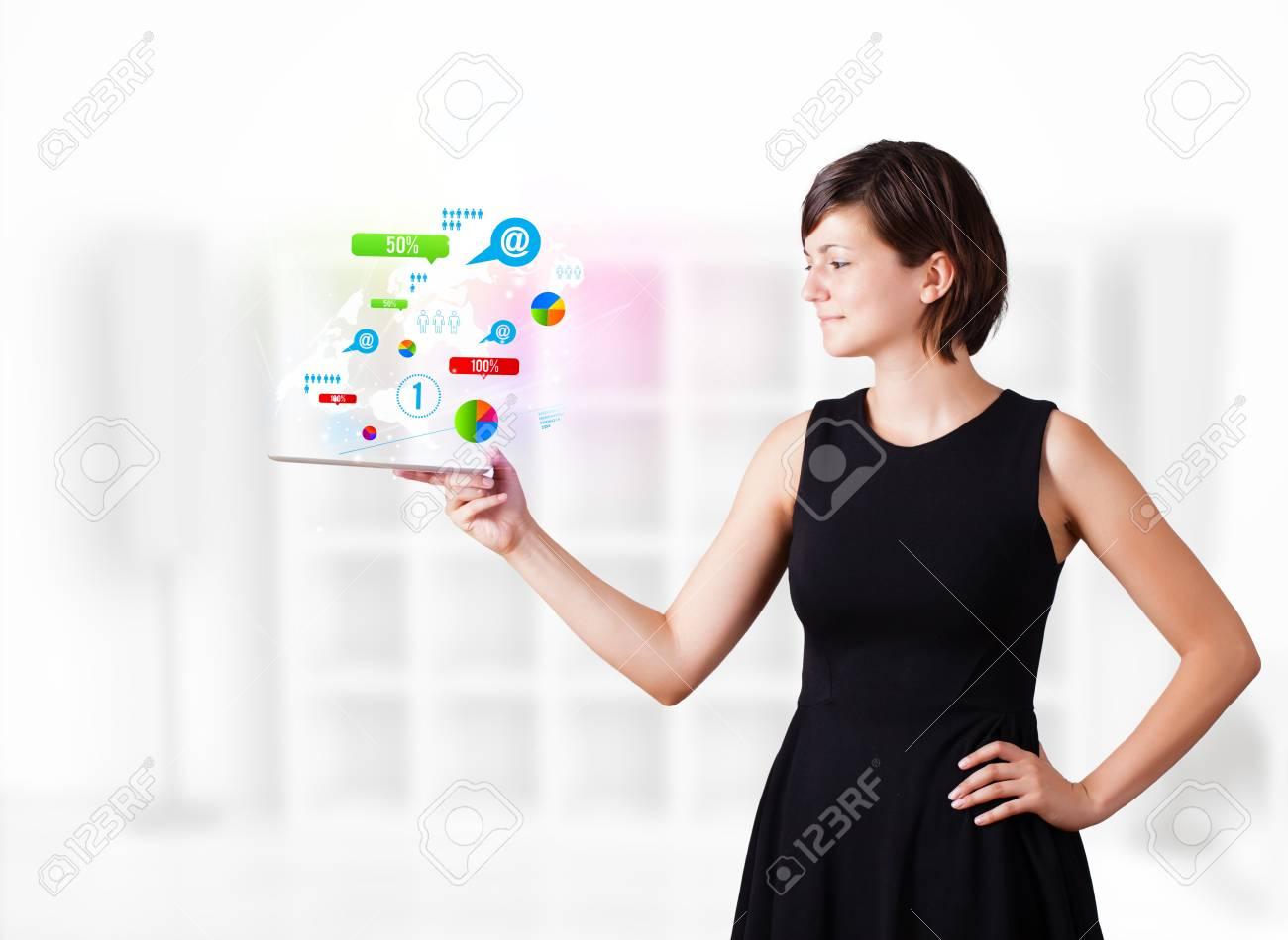 Young business woman looking at modern tablet with colourful technology icons Stock Photo - 16242528
