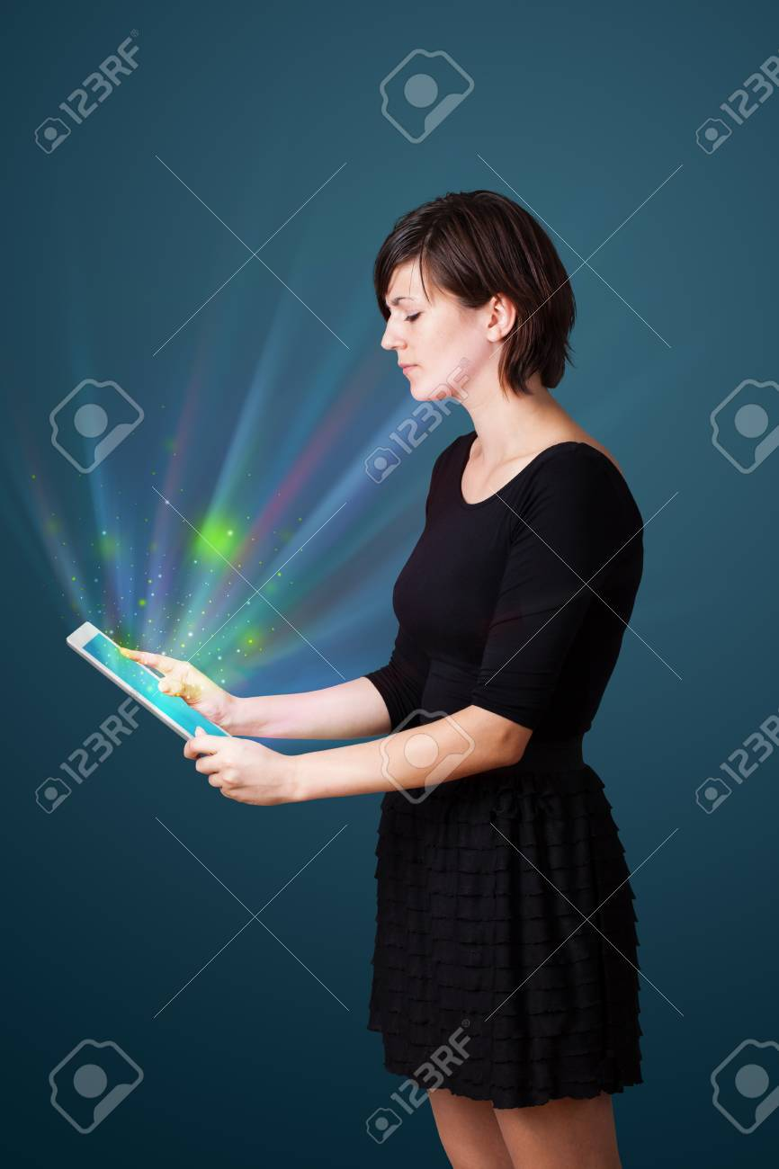 Young business woman looking at modern tablet with abstract lights Stock Photo - 16243328