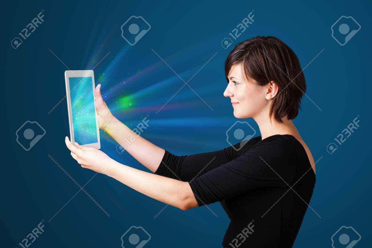 Young business woman looking at modern tablet with abstract lights Stock Photo - 16523929