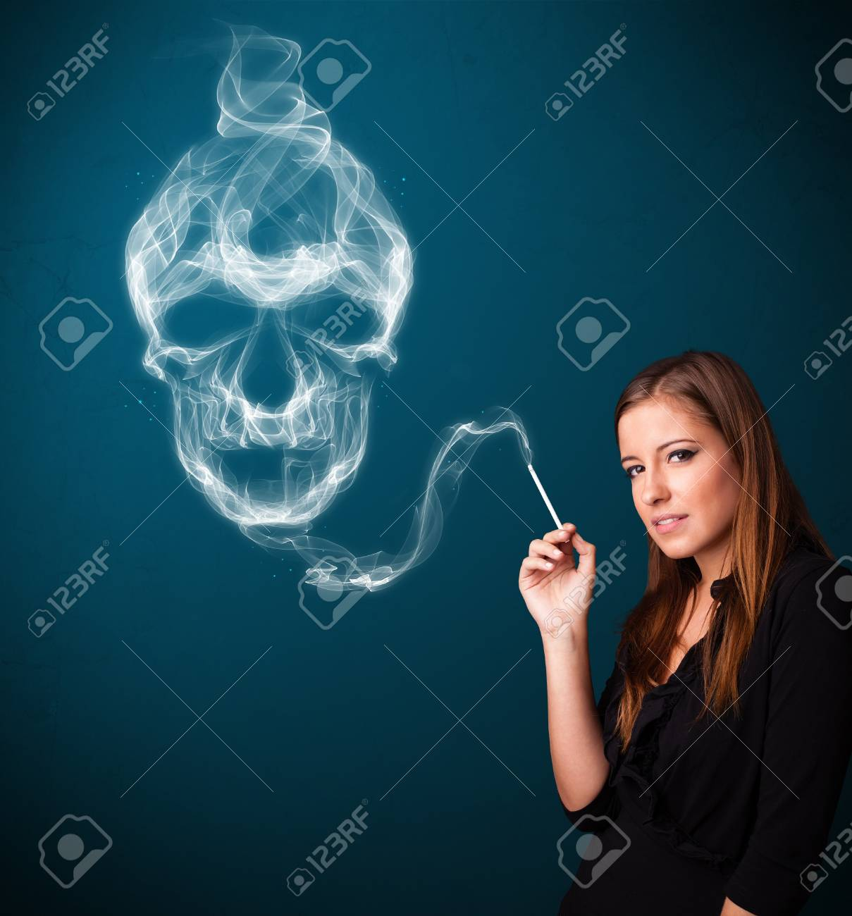 Pretty young woman smoking dangerous cigarette with toxic skull smoke Stock Photo - 16747001