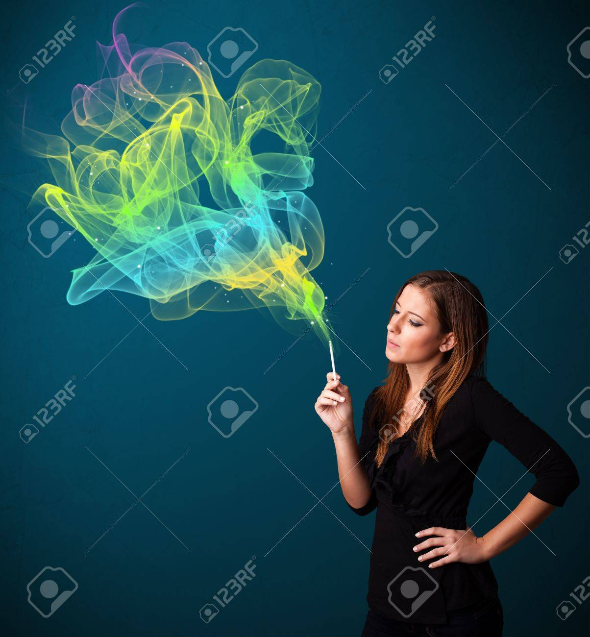 Pretty young lady smoking cigarette with colorful smoke Stock Photo - 16746786