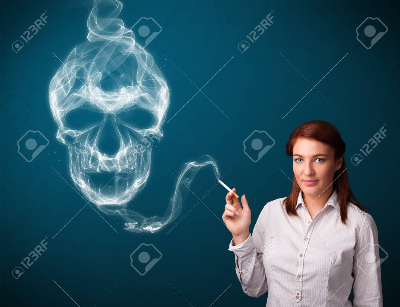 Pretty young woman smoking dangerous cigarette with toxic skull smoke Stock Photo - 16746851