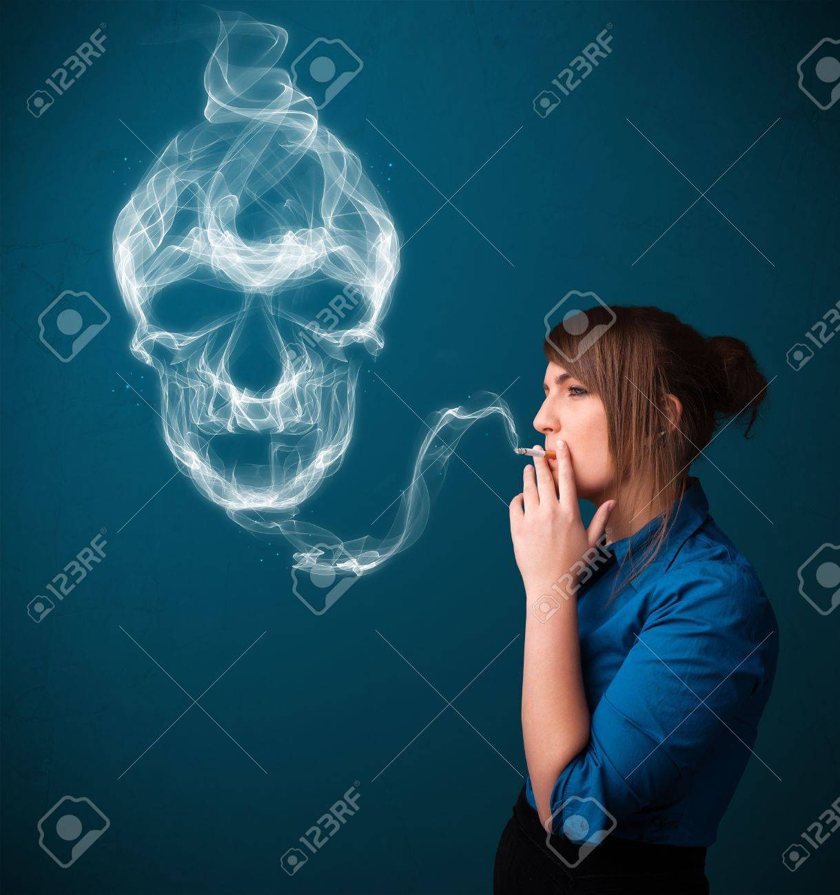 Pretty young woman smoking dangerous cigarette with toxic skull smoke Stock Photo - 16747295