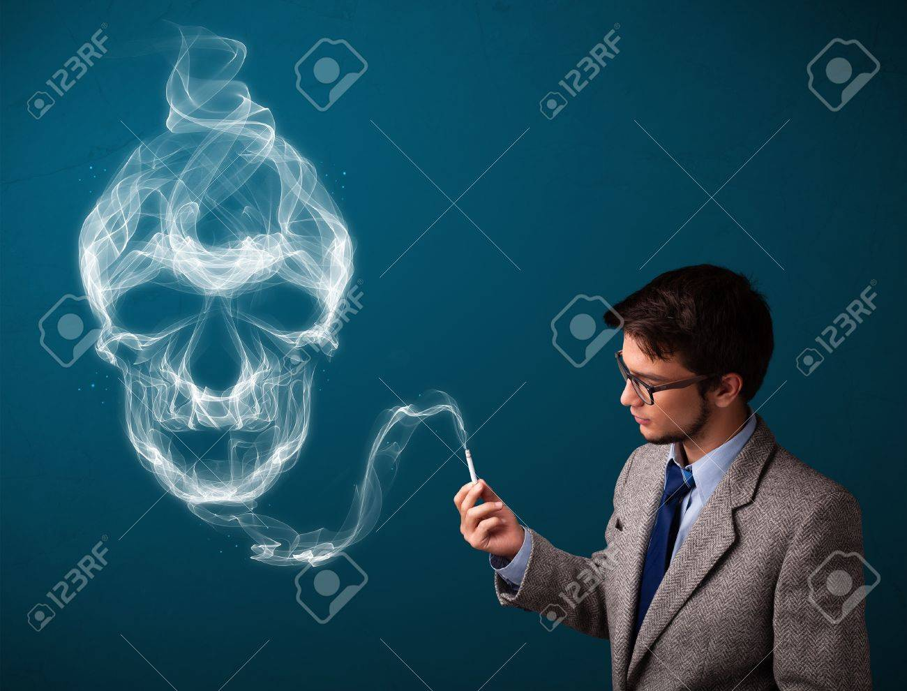 Handsome young man smoking dangerous cigarette with toxic skull smoke Stock Photo - 16746994