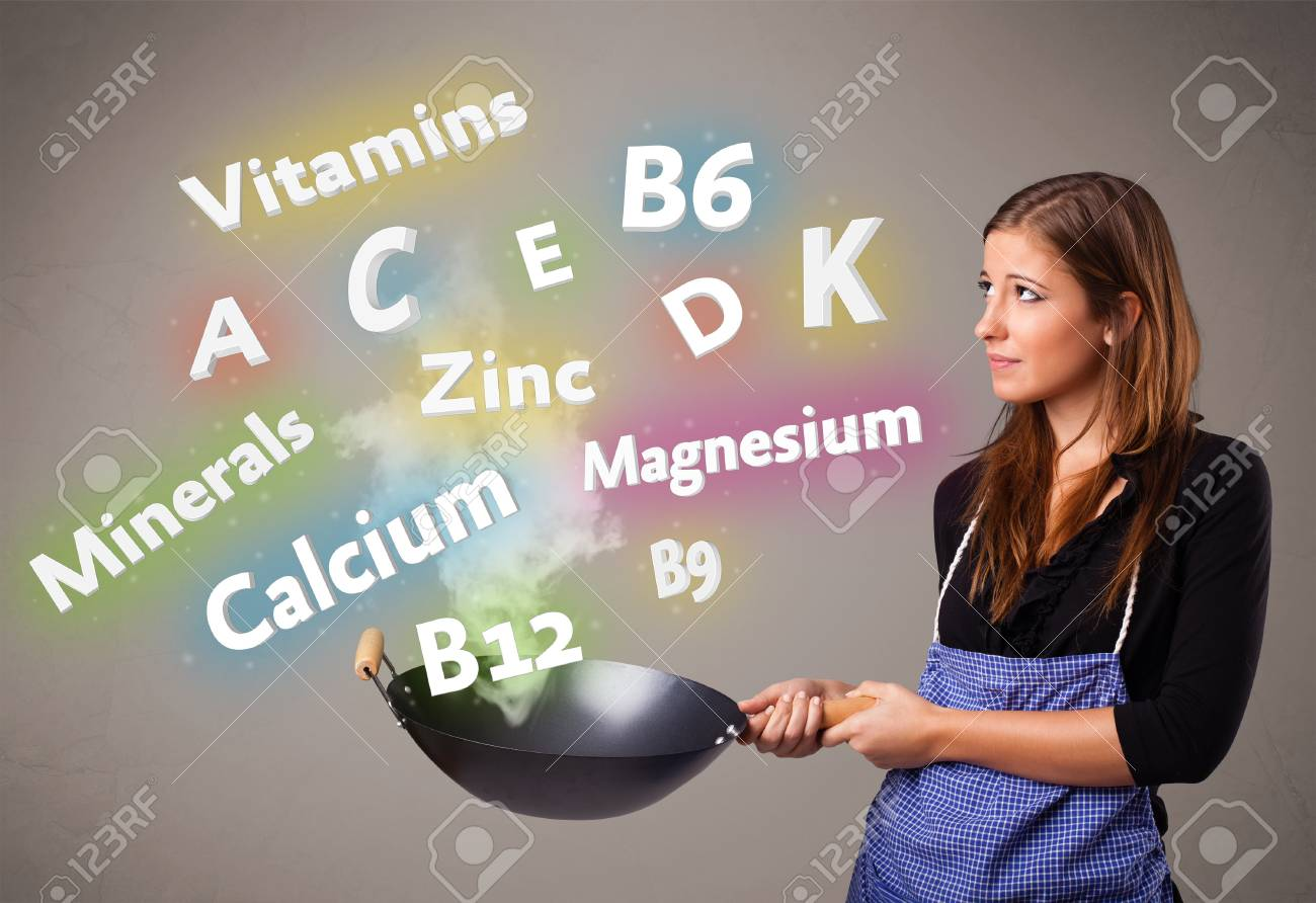 Pretty young woman cooking vitamins and minerals Stock Photo - 17455565