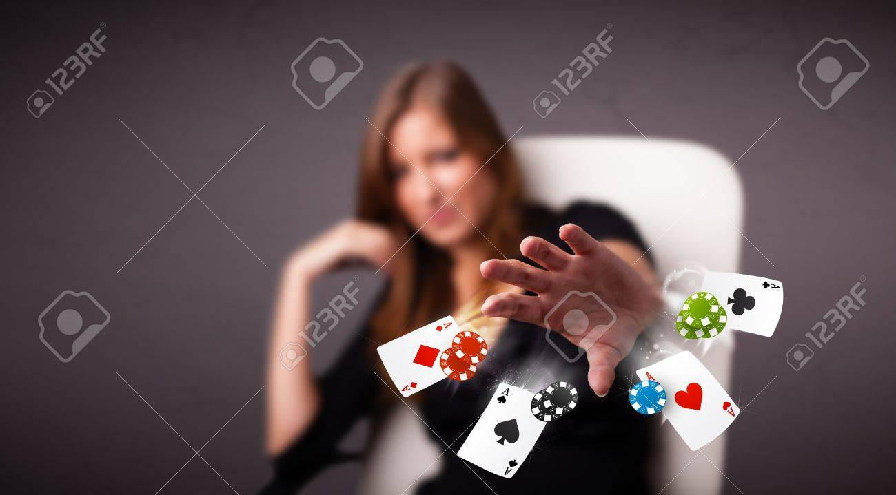 Pretty young woman playing with poker cards and chips Stock Photo - 17563565