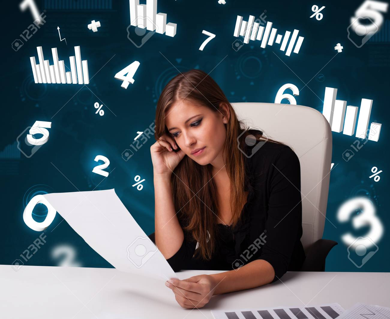 Pretty young businesswoman sitting at desk with diagrams and statistics Stock Photo - 17563501